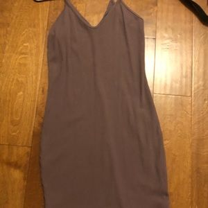 Light purple, form-fitting dress with a slight v